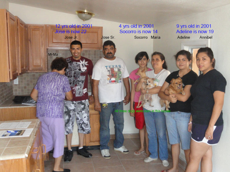 Jose's family in the kitchen of their reacquired home